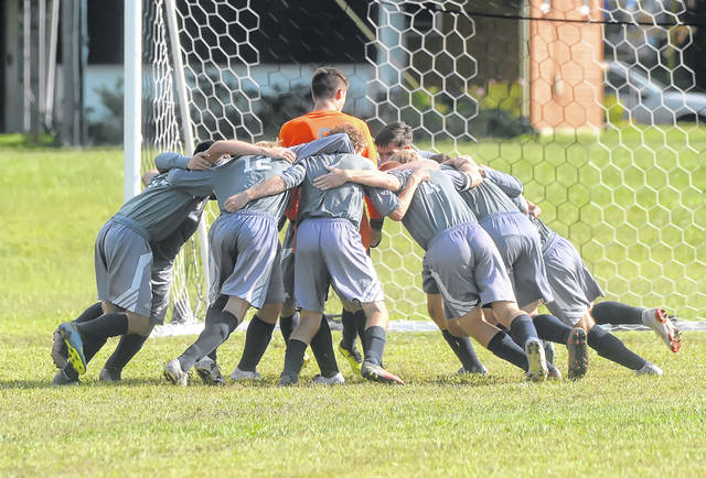 Temple Christian players prepare to compete against New Knoxville during Tuesday night's home match.