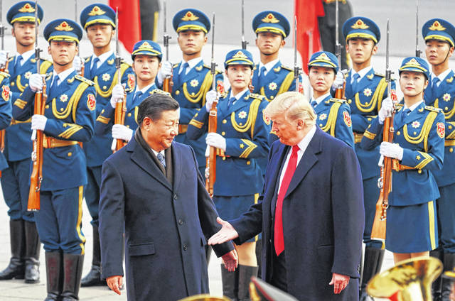From left, China's President Xi Jinping and U.S. President Donald Trump shake hands on November 9, 2017, during a meeting outside the Great Hall of the People in Beijing. (Artyom Ivanov/Tass/Abaca Press/TNS)
