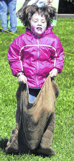 Kaitlyn Long masters the sack race at the Apple Festival at the Allen County Farm Park.
