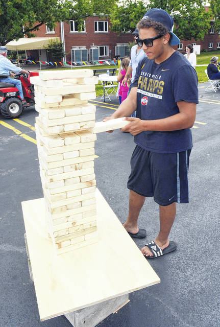 Dylan Knutsen plays a large game of Jenga at the Bluffton Fall Festival last year.