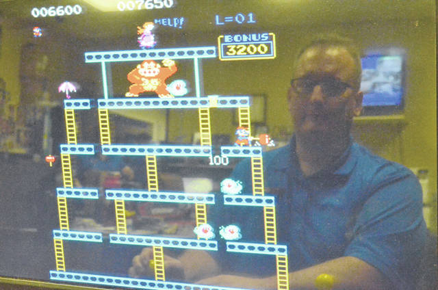 "Barry Electronics Sales Manager Jeff Smith, 41, of Elida, plays ""Donkey Kong"" on a arcade system in his store."