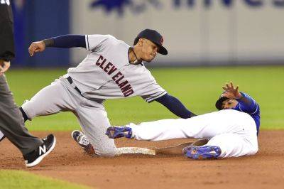 Cleveland Indians shortstop Francisco Lindor tags out the Blue Jays' Richard Urena at second base on a steal attempt during the third inning of Friday's game in Toronto. (AP photo)