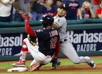 The Indians' Francisco Lindor slides in with a triple as Chicago White Sox's Yolmer Sanchez tries to field the throw during the eighth inning of Thursday night's game in Cleveland. (AP photo)