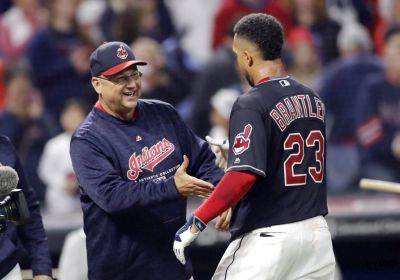 Indians manager Terry Francona, left, congratulates Michael Brantley after Brantley hit a winning RBI-single in the 11th inning of of Saturday night game against Boston in Cleveland. (AP photo)