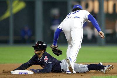 Cleveland's Francisco Lindor is tagged out by the Royals' Adalberto Mondesi during Thursday night's game in Kansas City, Mo. (AP photo)