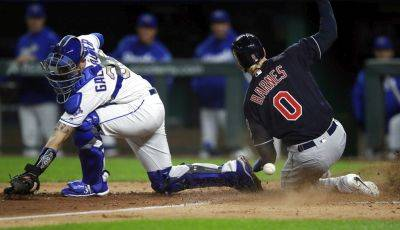 Cleveland's Brandon Barnes scores as the ball gets past Royals catcher Cam Gallagher during Friday night's game in Kansas City, Mo. (AP photo)