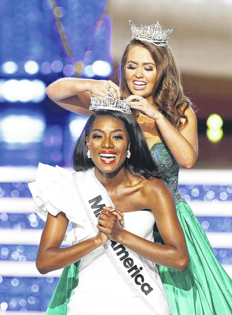 Miss New York Nia Franklin reacts after being named Miss America 2019, as she is crowned by last year's winner Cara Mund, on Sunday in Atlantic City, N.J. (AP Photo/Noah K. Murray)