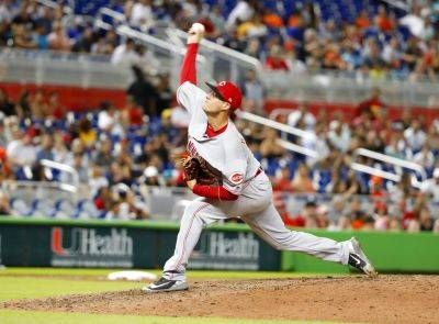 Cincinnati's Matt Wisler pitches during the eighth inning of Saturday night's game against the Marlins in Miami. (AP photo)