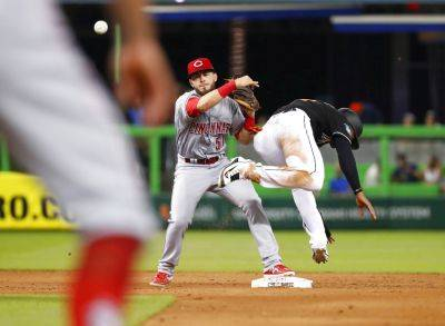Cincinnati shortstop Blake Trahan (51) throws to first for the double play as the Marlins' Isaac Galloway dives for second during the eighth inning of Friday's game, in Miami. (AP photo)