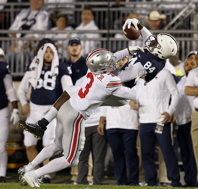 Penn State's Juwan Johnson (84) makes a catch as Ohio State's Damon Arnette (3) defends during the first half of an NCAA college football game in State College, Pa., Saturday.