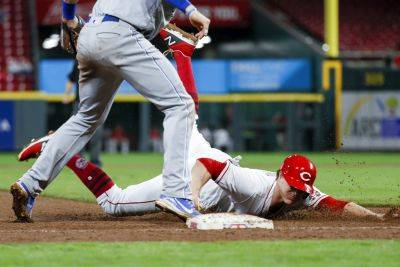 The Reds' Brandon Dixon is forced out at third by Kansas City's Hunter Dozier in the ninth inning of Tuesday night's game in Cincinnati. (AP photo)