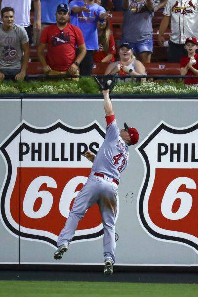 Cincinnati Reds right fielder Scott Schebler (43) makes a leaping catch for an out on a ball hit by the Cardinals' Patrick Wisdom during the eighth inning of Friday night's game in St. Louis. (AP photo)