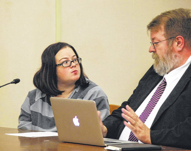 Vicky Shellabarger of Convoy talks with her attorney, Steve Chamberlain, during a hearing Wednesday in Allen County Common Pleas Court. Shellabarger, charged with murder in the April death of her infant daughter, waived her right to a speedy trial during the hearing.