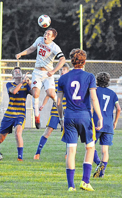 Kenton's Patrick Bartlett leaps among St. Marys Roughrider midfielders to head the ball in a Western Buckeye League match at St. Marys.