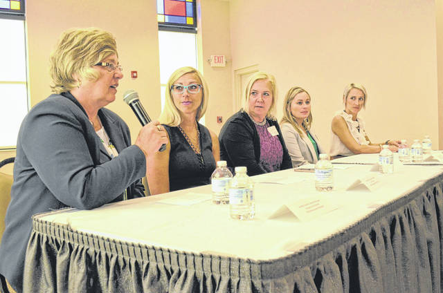 Annette Swisher, from left, speaks while Ann Rea Miller, Lisa Niekamp-Urwin, Julianne Frankhouser and Jacquelyn Beckner look on during a panel discussion Thursday during a Women In Business meeting. The women discussed issues central to women in business careers.