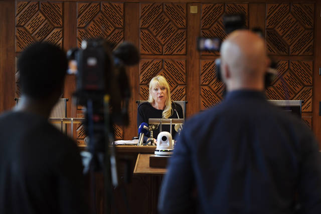 Judge Gudrun Antemar speaks from the district court in Stockholm, Monday Oct. 1, 2018. Jean Claude Arnault, the man at the center of a sex-abuse and financial crimes scandal that is tarnishing the academy that awards the Nobel Prize in Literature, was convicted Monday and sentenced to two years in prison for a rape in 2011. (Anders Wiklund/TT via AP)