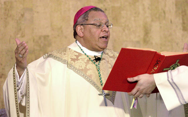 FILE - In this 2007 file photo, Bishop George Murry celebrates mass at Saint Columba Cathedral in Youngstown, Ohio. The Roman Catholic diocese was the first in Ohio to announce that it would release a list of priests who have been removed from parishes because of sexual abuse and misconduct allegations. Now The Associated Press has learned that a second Ohio diocese, Steubenville, plans to release a list.
