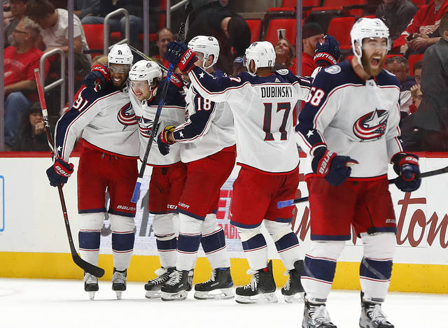 Columbus Blue Jackets' Artemi Panarin, second from left, celebrates his goal against the Detroit Red Wings in overtime during an NHL hockey game Thursday, Oct. 4, 2018, in Detroit. Columbus won 3-2. (AP Photo/Paul Sancya)