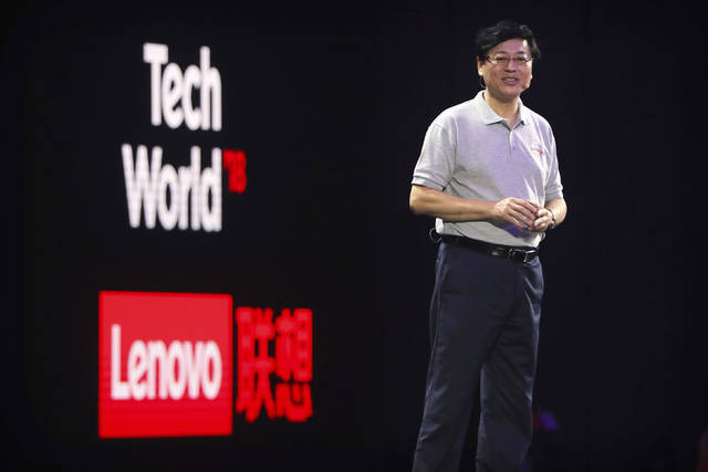 FILE - In this Sept. 27, 2018, file photo, Lenovo chairman and CEO Yang Yuanqing delivers a keynote speech during the Lenovo Tech World summit in Beijing. Chinese tech stocks Lenovo Group and ZTE Corp. have tumbled in Hong Kong following a news report Chinese spies might have used chips supplied by another company to hack into U.S. computer systems. (AP Photo/Mark Schiefelbein, File)