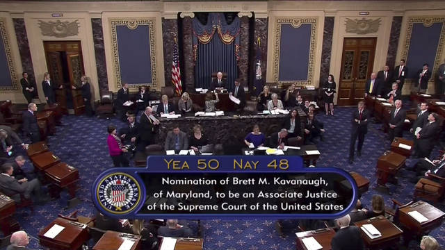 Vice President Mike Pence announces the result of the vote for the confirmation of Brett Kavanaugh to the Supreme Court in Washington. The bitterly polarized U.S. Senate narrowly confirmed Brett Kavanaugh on Saturday to join the Supreme Court, delivering an election-season triumph to President Donald Trump that could swing the court rightward for a generation after a battle that rubbed raw the country's cultural, gender and political divides. (AP Photo/APTN)
