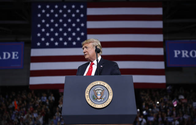 President Donald Trump pauses while speaking during a campaign rally at Kansas Expocentre, Saturday, Oct. 6, 2018 in Topeka, Kan. (AP Photo/Pablo Martinez Monsivais)