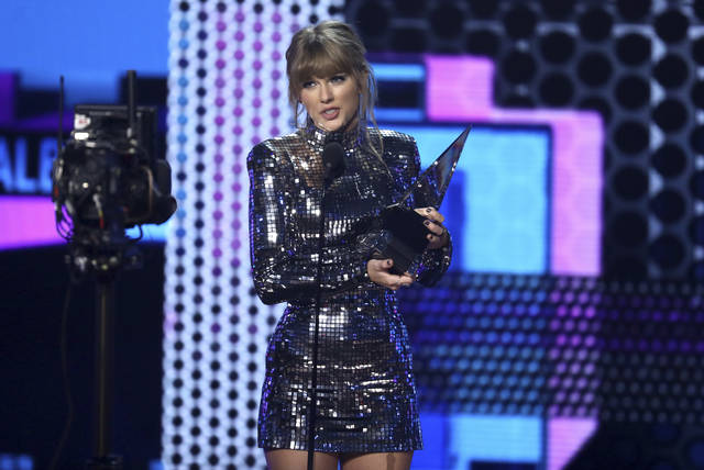 "Taylor Swift accepts the award for favorite pop/rock album for ""Reputation"" at the American Music Awards on Tuesday at the Microsoft Theater in Los Angeles."