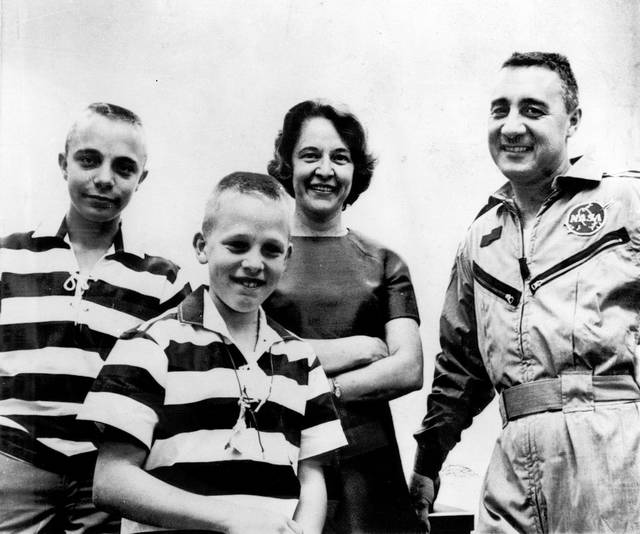 "FILE - In this March 25, 1965 file photo, astronaut Virgil I. Grissom is reunited with his wife and sons at Cape Kennedy, Fla., after his three-orbit flight. From left: Scott (14), Mark (11), and Mrs. Betty Grissom. Betty Lavonne Grissom, the widow of astronaut Virgil ""Gus"" Grissom who successfully sued a NASA contractor after his death in the 1967 Apollo launch pad fire, has died. She was 91."