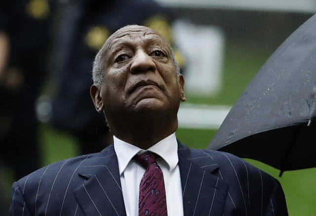 FILE - In this Sept. 25, 2018, file photo, Bill Cosby arrives for his sentencing hearing at the Montgomery County Courthouse in Norristown, Pa. Cosby, now inmate No. NN7687 in a Pennsylvania prison, was not slapped with a chicken patty during a food fight despite reports circulating online. (AP Photo/Matt Slocum, File)