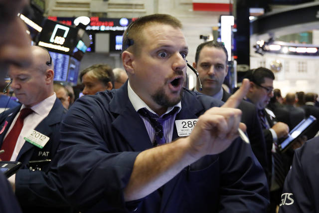 Trader Michael Milano works on the floor of the New York Stock Exchange, Monday, Oct. 15, 2018. Stocks are opening mostly lower as technology companies continue to fall. (AP Photo/Richard Drew)