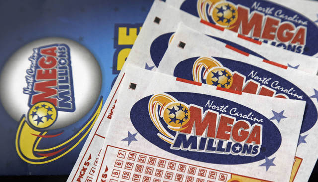 Mega Millions lottery tickets can be seen on a counter at a Pilot travel center near Burlington, N.C., in 2016. After nearly three months without a winner, the Mega Millions lottery game has climbed to an estimated $654 million jackpot.