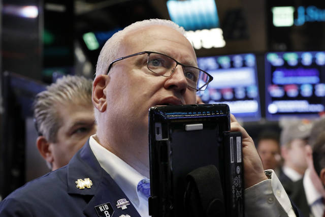 FILE- In this Oct. 11, 2018, file photo trader Thomas Ferrigno works on the floor of the New York Stock Exchange. The U.S. stock market opens at 9:30 a.m. EDT on Tuesday, Oct. 16. (AP Photo/Richard Drew, File)