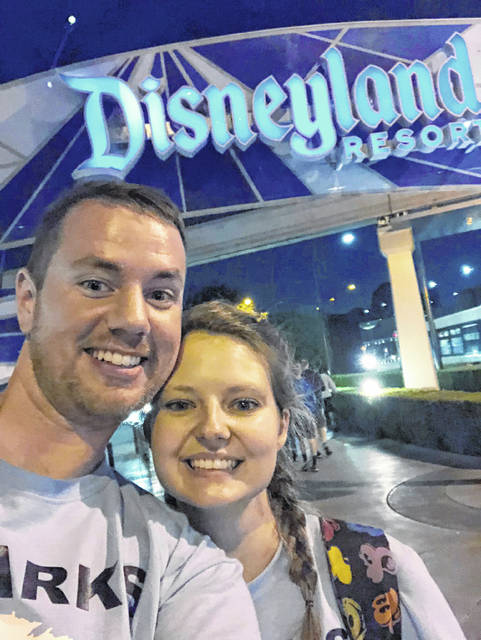 Clark Ensminger and his wife, Heather Ensminger, pose for a picture at Disneyland in Anaheim, Calif. The couple visited four Disney parks in the Orlando, Fla., area and two Disney parks in the Los Angeles area, with a cross-country flight in between, all within 20 hours and two time-zone changes.