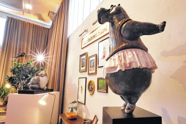 A bronze hippo by Danish sculptor Bjorn Okholm Skaarup appears during a preview of the Neiman Marcus Christmas Book on Thursday in New York. Skaarup can cast a family pet or favorite creature, complete with a trip to Florence, Italy, to spend time with the artist at his foundry, for $200,000-plus, depending on the size of the bronze tribute.