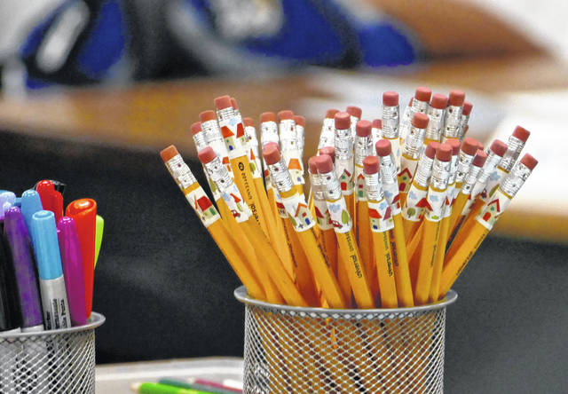 Pencils are at the ready on a teacher's desk in 2017 at Bruns Academy in Charlotte, N.C. The Educator Expense Deduction is a $250 tax deduction to help recoup out-of-pocket costs for outfitting a classroom, getting training or buying teaching materials.