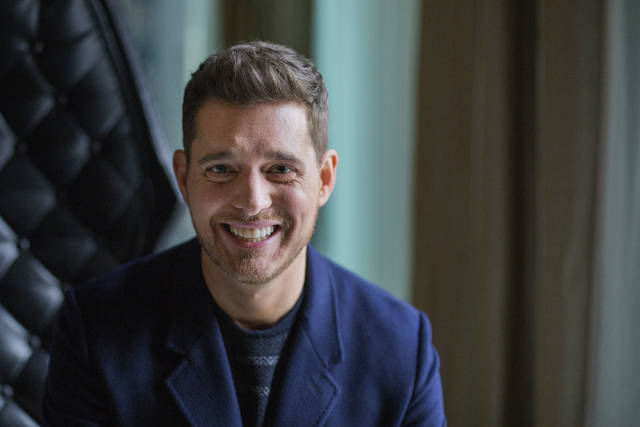 "FILE - In this Oct. 18, 2016 file photo,Canadian singer Michael Buble poses for a photo to promote the upcoming Oct. 21 release of his new album ""Nobody But Me"" in Toronto. The Canadian singer is not retiring from music despite reports circulating online. In an interview with The Associated Press, Buble disputed a report in the Daily Mail that said he was quit after the release of his upcoming album ""Love,"" due out Nov. 16. The report suggested that the Grammy-winning singer was stepping away from music for good following his son Noah's cancer battle. Buble responded to the report saying, ""I'll keep going until the news of my death comes out, which will probably be fake too."" (Michelle Siu/The Canadian Press via AP, File)"