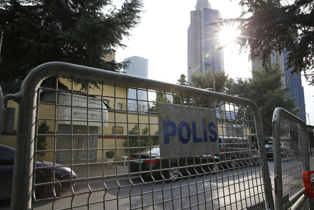 "Barriers block the road leading to Saudi Arabia's consulate, background, in Istanbul, Saturday, Oct. 20, 2018. Turkey will ""never allow a cover-up"" of the killing of Saudi journalist Jamal Khashoggi in Saudi Arabia's consulate in Istanbul, a senior official in Turkey's ruling party said Saturday after Saudi Arabia announced hours earlier that the writer died during a ""fistfight"" in its consulate. (AP Photo/Lefteris Pitarakis)"