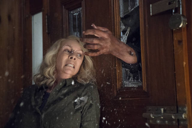 "This image released by Universal Pictures shows Jamie Lee Curtis in a scene from ""Halloween,"" in theaters nationwide since Friday."