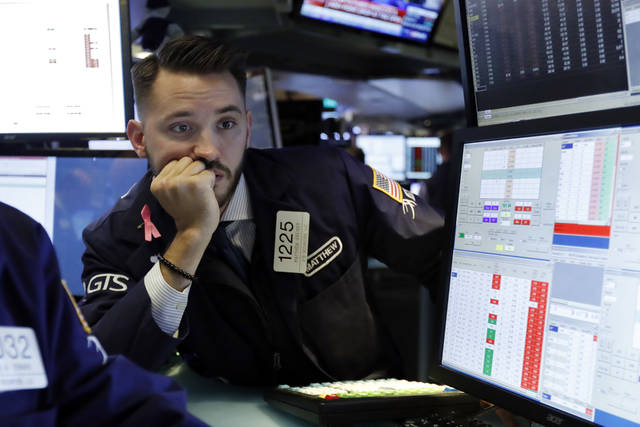 Specialist Matthew Grenier works on the floor of the New York Stock Exchange, Tuesday, Oct. 23, 2018. Stocks are opening sharply lower on Wall Street following big drops in Asia and Europe. (AP Photo/Richard Drew)