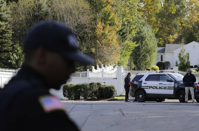 "Police officers stand in front of property owned by former Secretary of State Hillary Clinton and former President Bill Clinton in Chappaqua, N.Y., Wednesday, Oct. 24, 2018. A U.S. official says a ""functional explosive device"" was found at the Clinton's suburban New York home. (AP Photo/Seth Wenig)"