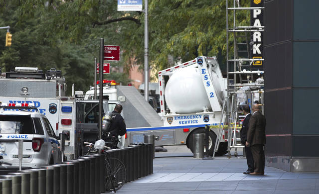 An NYPD bomb squad vehicle departs an area outside Time Warner Center on Wednesday, Oct. 24, 2018, in New York. Law enforcement officials say a suspicious package that prompted an evacuation of CNN's offices is believed to contain a pipe bomb. (AP Photo/Kevin Hagen)