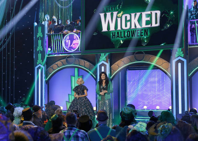 "Kristin Chenoweth, left, and Idina Menzel appear in the Halloween-themed TV special ""A Very Wicked Halloween: Celebrating 15 Years On Broadway,"" airing on NBC at 10 p.m. Monday. Chenoweth and Menzel were original stars of the Broadway production."