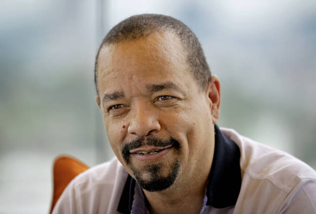 FILE - In this June 11, 2012 file photo shows rapper and actor Ice-T in Atlanta.  Police arrested Ice-T for failing to pay a toll at the George Washington Bridge.  The actor and rapper was ticketed for theft of services on Wednesday, Oct. 24, 2018,  when he drove through E-ZPass leading to the span that connects New Jersey with New York. The 60-year-old, whose real name Tracy Marrow, was driving a new McLaren sports car and was also ticketed for not having license plates and registration.  (AP Photo/David Goldman, File)