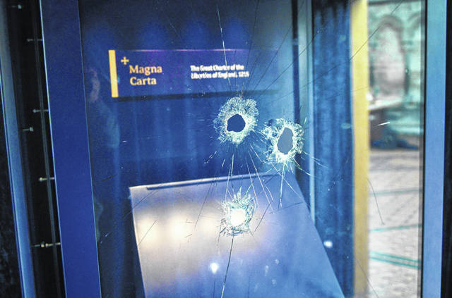 Hammer holes can be seen in the glass case that housed the Magna Carta at Salisbury Cathedral. A 45-year-old man has been arrested on suspicion of its attempted theft in Salisbury, England. British police said Friday that cathedral alarms sounded Thursday when a person tried to smash the glass display box surrounding the Magna Carta in Salisbury Cathedral, and a man has been arrested.
