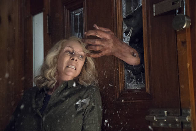 "This image released by Universal Pictures shows Jamie Lee Curtis in a scene from ""Halloween."" (Ryan Green/Universal Pictures via AP)"