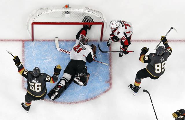 Vegas Golden Knights right wing Alex Tuch, right, celebrates after scoring against Ottawa Senators goaltender Craig Anderson (41) during overtime of an NHL hockey game, Sunday, Oct. 28, 2018, in Las Vegas. (AP Photo/John Locher)