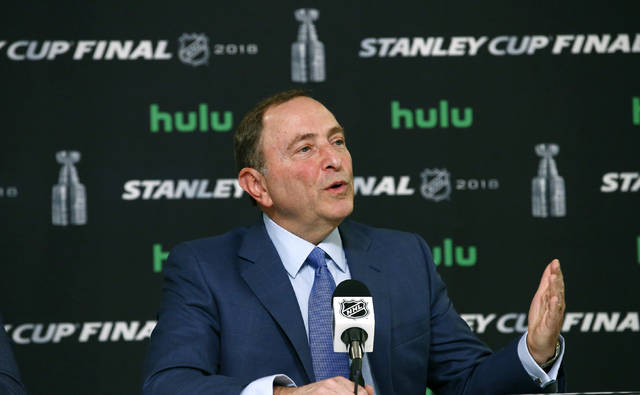 FILE - In this May 28, 2018 file photo NHL Commissioner Gary Bettman speaks during a news conference prior to Game 1 of the NHL Stanley Cup Final hockey game between the Vegas Golden Knights and the Washington Capitals in Las Vegas. The NHL is following the NBA's lead by partnering with MGM Resorts International and providing the company with data for use in sports betting. Bettman announced the agreement Monday, Oct. 29. Las Vegas-based MGM is the league's first official sports betting partner. (AP Photo/Ross D. Franklin, File)