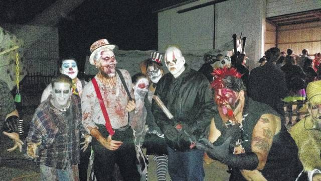A group of actors at Hammer Brothers Haunted Circus in Waynesfield get into character before going out into the haunted corn maze during a past year.