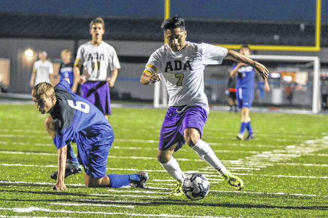 Allen East's Ethan Reichenback gets up to give chase to Ada's Christopher Reyes during Tuesday night's Northwest Conference match at Allen East.