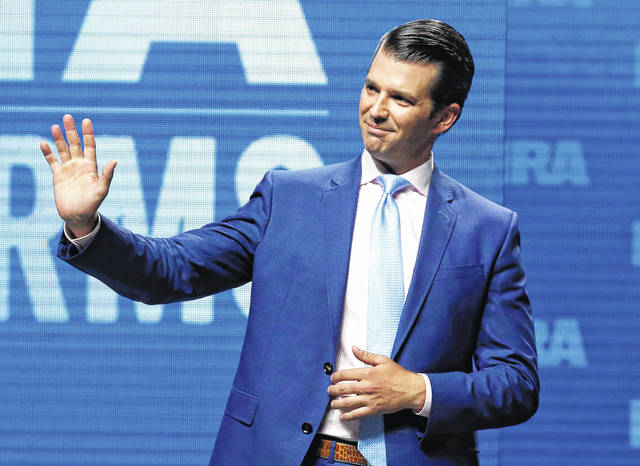 FILE - In this May 4, 2018, file photo, Donald Trump Jr., waves from the stage at the National Rifle Association in Dallas. Donald Trump Jr. will speak this week in Lima.