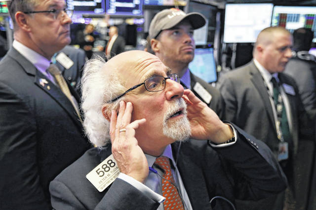 Trader Peter Tuchman works on the floor of the New York Stock Exchange, Thursday, Oct. 11, 2018. The market's recent decline was set off by a sharp drop in bond prices and a corresponding increase in yields last week and early this week.